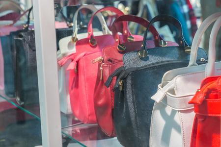 portmanteau: Row of Ladies leather handbags Stock Photo