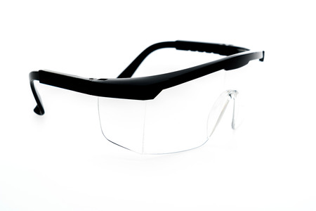 protective: Plastic Protective Work Glasses on a White Background Stock Photo