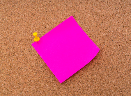 post it notes: Post it notes on cork board