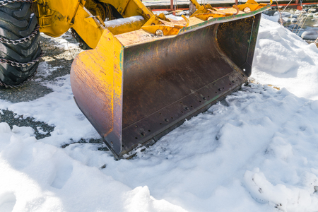 snow plow: Tractor with snow plow in winter