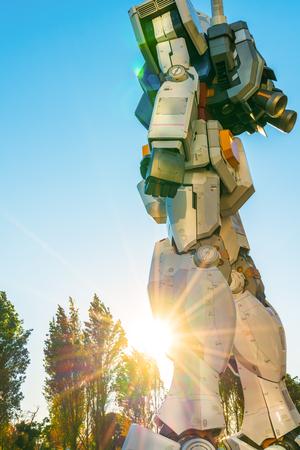 full size: Full size Gundam Performances Outside DiverCity Tokyo Plaza, Odaiba, Tokyo, Japan - 27 November 2015: It is 18m tall The sculpture of famous anime franchise robot, Gundam.