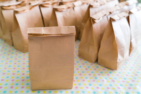 Brown paper bags on table