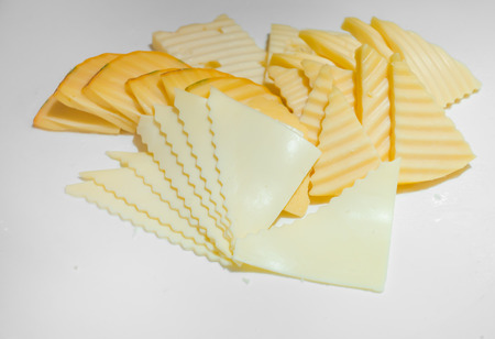 cheez: Piece of cheese on white plate Stock Photo