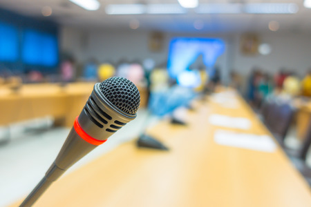 lecturing: Black microphone in conference room ( Filtered image processed vintage effect. ) Stock Photo