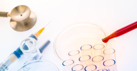 laboratory test tubes,medical glassware , Stethoscope,plastic syringe  ( Filtered image processed colorful effect. ) Stock Photo