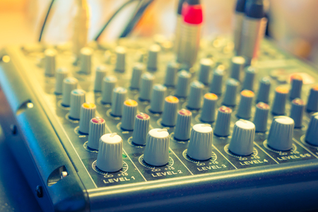 turn table: Music mixer desk with various knobs ( Filtered image processed vintage effect. ) Stock Photo