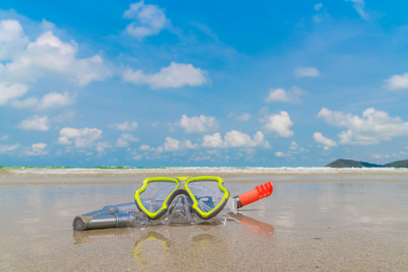 diving equipment: Scuba Diving Equipment On The White Sea Sand Beach Stock Photo