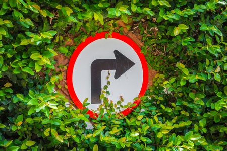 turns: Turns to the right sign with green leaf Stock Photo