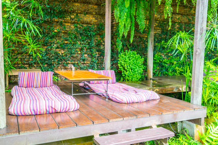 roofed house: Relaxation space in garden with beds Stock Photo