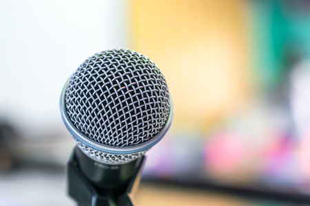 dais: Black microphone in conference room ( Filtered image processed vintage effect. ) Stock Photo