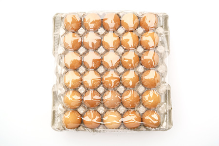 food products: Fresh eggs in package on White Background