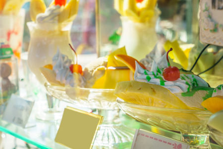display case: Plastic cake in a display case Stock Photo