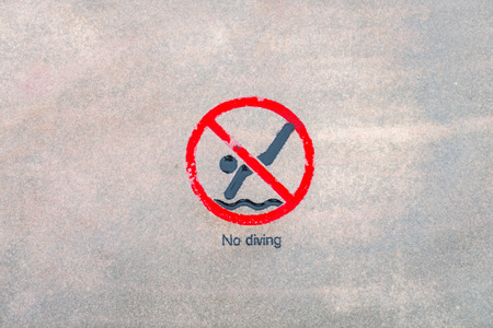 no diving sign: No diving warning sign at the poolside Stock Photo