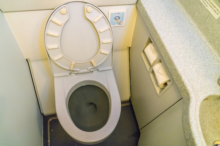 Aircraft lavatory toilets aboard a jetliner airplane