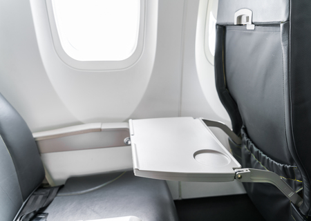 Airplane tray table on seat back