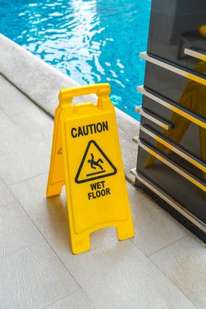 no swimming sign: Warning sign at  swimming pool