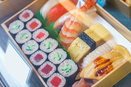 Plastic Sushi rolls in a display case