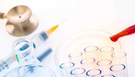 dropper: laboratory test tubes,medical glassware , Stethoscope,plastic syringe  ( Filtered image processed colorful effect. ) Stock Photo