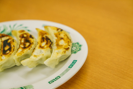 crave: Gyoza on table Stock Photo