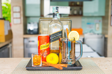 Bangkok,Thailand - October 09,2015: Johnnie Walker BLACK LABEL extraspecial old Scotch Whisky bottle And Schweppes Sparkling Tqnic Watrer is a beverage brand with a variety of carbonated waters and ginger Popular Schweppes products ginger ale, introduced