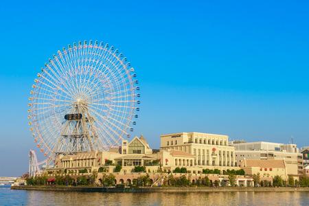 third wheel: Yokohama,Japan - November 24,2015 : Ferris wheel at cosmo world fun park at minato mirai , Yokohama is the third biggest city in Japan. Editorial