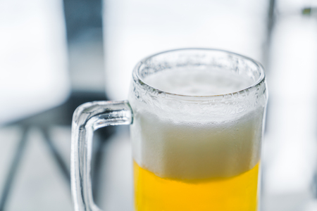 un bottled: Mug with beer on table
