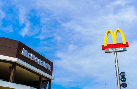 Khonkaen Province, Thailand - December 20, 2015 : McDonalds logo on blue sky McDonalds Corporation is the worlds largest chain of hamburger fast food restaurants. Editorial