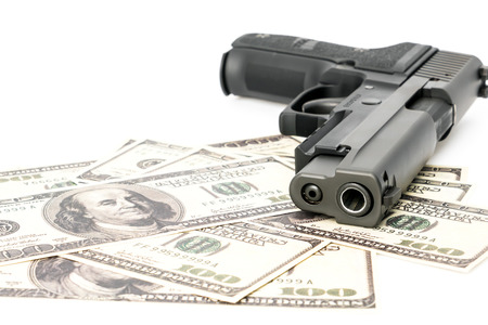 Close up image of pistol and dollar Stock Photo