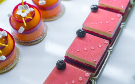 brightly: Brightly colored cakes  in refrigerator Stock Photo