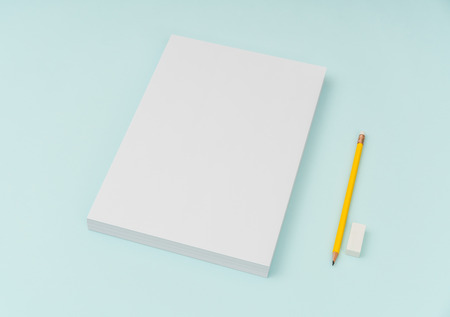 Blank flyer poster, brochure mockup,A4, US-Letter, with pencil  on blue background Stock Photo