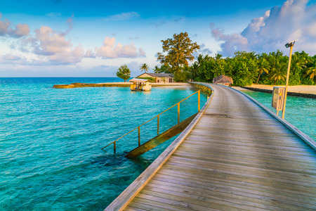 Beautiful water villas in tropical Maldives island at the sunrise time Stock Photo