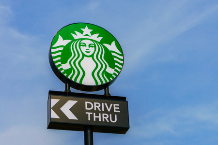 thru: Khonkaen Province, Thailand - December 20, 2015 : Starbucks drive thru sign at 200th store at FastFac Mini Factory one of the fastest growing industrial