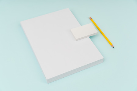 Blank flyer poster, brochure mockup,A4, US-Letter, with business card and pencil on blue background