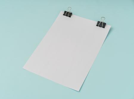 Blank flyer poster, brochure mockup,A4, US-Letter, on blue background Stock Photo