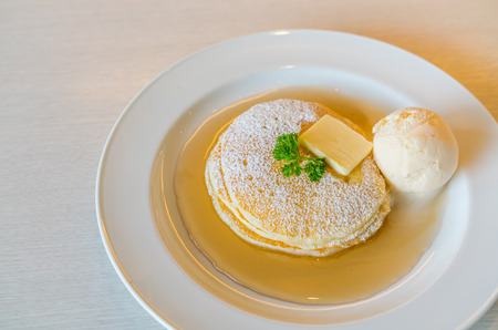 Pancake  with ice cream on table