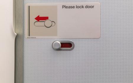 Airplane lavatory lock door