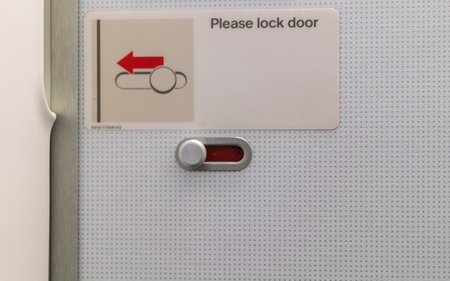Airplane lavatory lock door