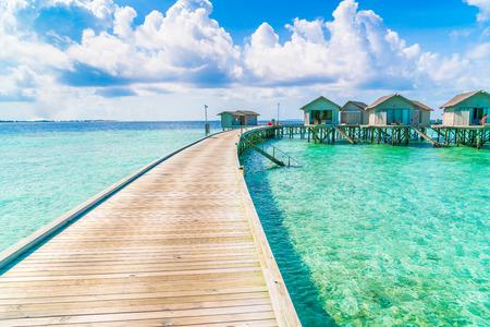 Beautiful water villas in tropical Maldives island Editorial