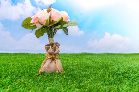 Beautiful of artificial flowers on grass Stock Photo