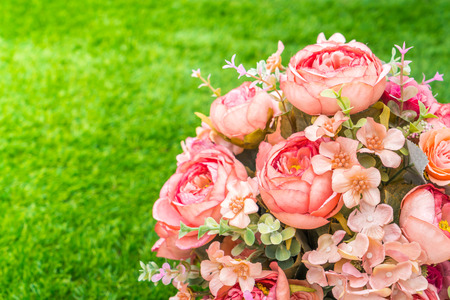 white fabric texture: Beautiful of artificial flowers on grass Stock Photo