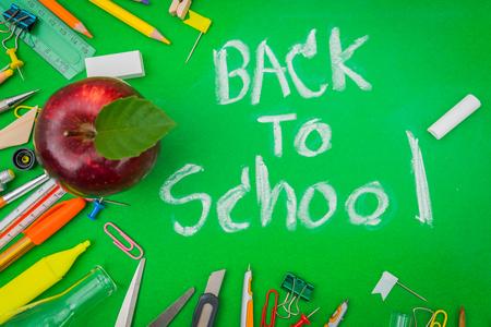 School supplies on Green chalkboard  Back to school background