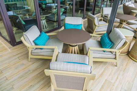 round chairs: Tables and chairs in restaurant