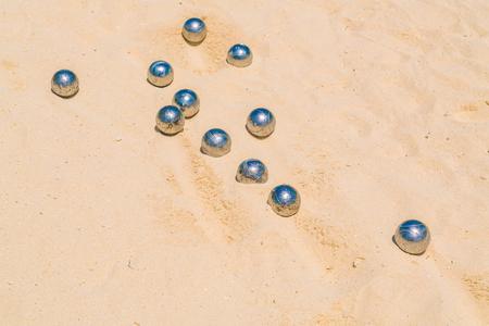 bocce: Bocce balls on white sandy beach
