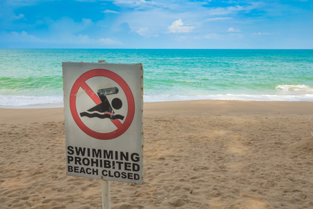 No swimming sign on  beach