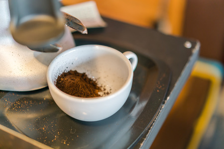 Used coffee grounds from espresso machine Stock Photo