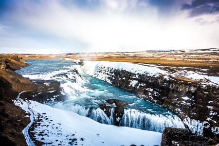 Beautiful famous waterfall in Iceland,winter season ( Filtered image processed vintage effect. )