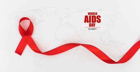Aids Awareness Red heart Ribbon on world map