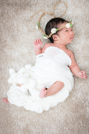 Cute newborn girl on a blanket. Stock Photo