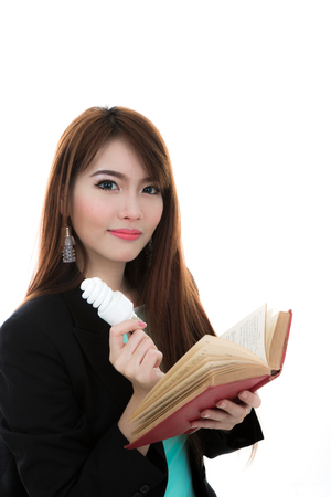 Portrait of smart female  with book and light bulb  for idea Stock Photo