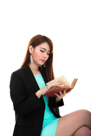 Portrait of beautiful girl hold her book against white background
